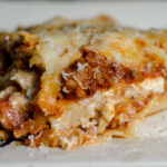 Easy, classic meat lasagna. Step-by-step pictures and instructions, printable recipe. Two meats, three cheeses, and delicious.