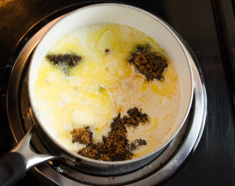 In a medium saucepan, heat dark brown sugar, heavy cream, butter, and dark corn syrup.