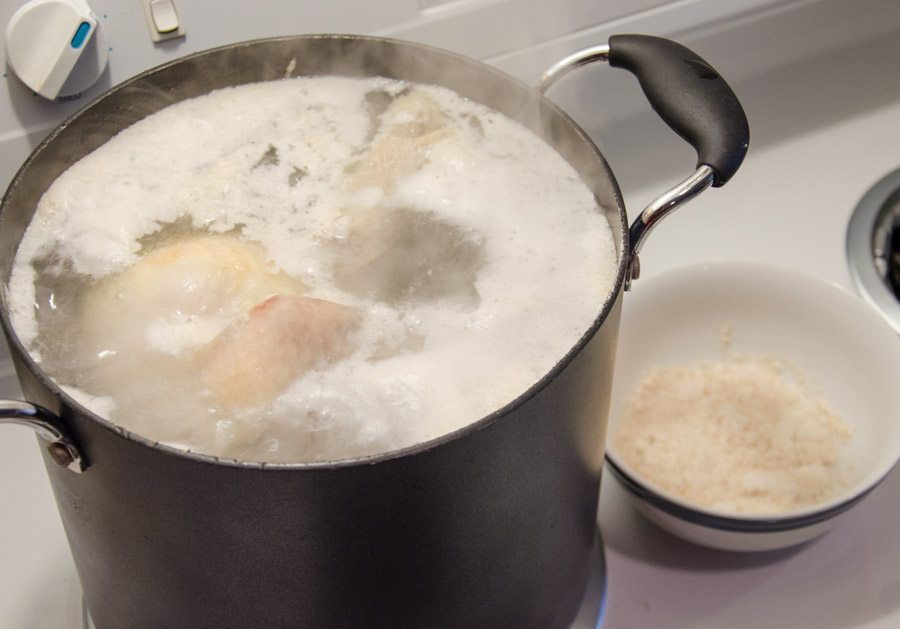 Boil a chicken and let it simmer until meat falls off the bones.