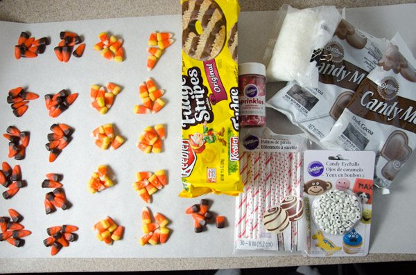 Ingredients to decorate: candy corns (6 for each turkey), Keebler fudge stripe cookies, lollipop sticks, candy eyes, heart-shaped sprinkles, candy melts, and paramount crystals (or shortening)