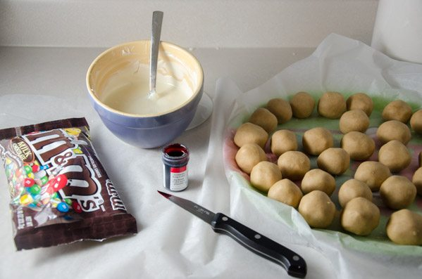 Prep: melt chocolate according to recipe directions. Have buckeyes and M&Ms ready.