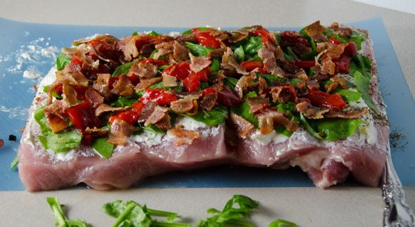 Tuscan-Style Pork Loin: tender, moist, & flavorful. Pork stuffed with cream cheese, bacon, pesto, roasted peppers, and more.