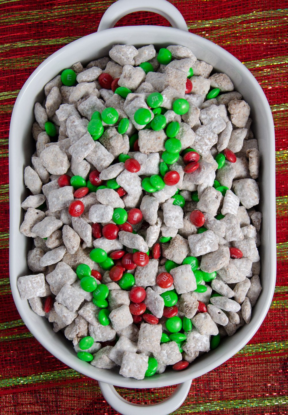 Overhead view of reindeer chow with red and green cloth underneath.