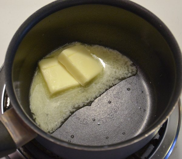 In a small pan, melt butter.
