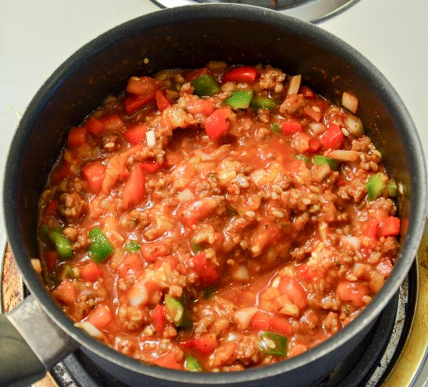 Mix sausage, pulp, vegetables, Italian seasoning, and spaghetti sauce in a medium pan. Bring to a boil. Reduce heat; simmer for 5 min.