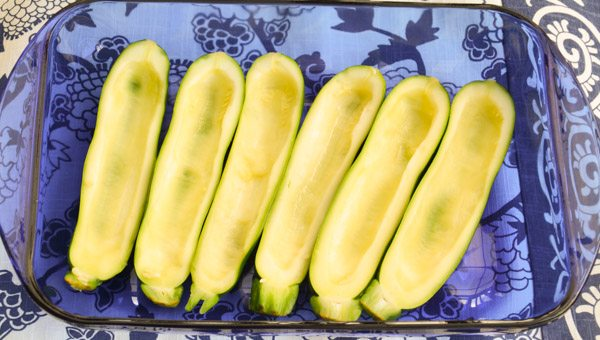 "Place zucchini ""shells"" in a glass baking dish."