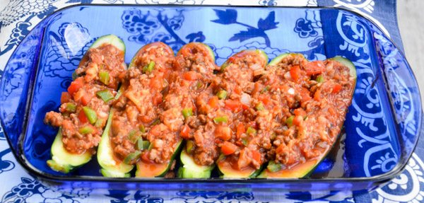 "Fill zucchini shells with Italian sausage and vegetable ""stuffing""."