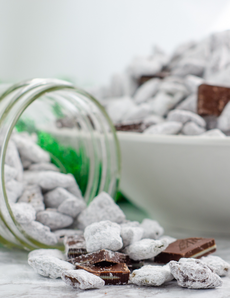 Andes Mint Muddy Buddies, Andes Mint Puppy Chow. Delicious mint chips and chocolate chips combine into puppy chow topped with Andes mints. Mint chocolate muddy buddies...a delicious and easy treat!