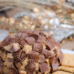 Reese's Peanut Butter Cup Cheese Ball. This to-die-for dessert (or appetizer!) is easy to make and absolutely delicious. I always catch at least one guest eating it with a spoon instead of on the graham crackers.