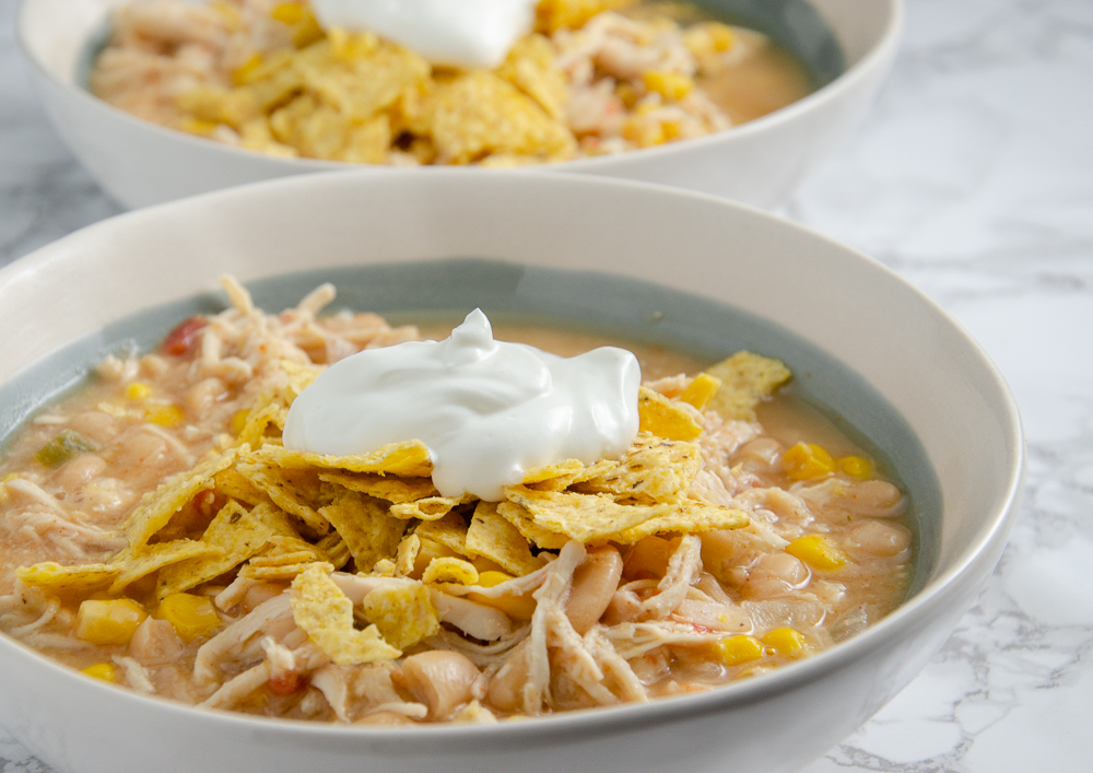 Slow Cooker White Chicken Chili. Delicious, easy white chicken chili. I always make a double batch and freeze half! Fabulous freezer meal.