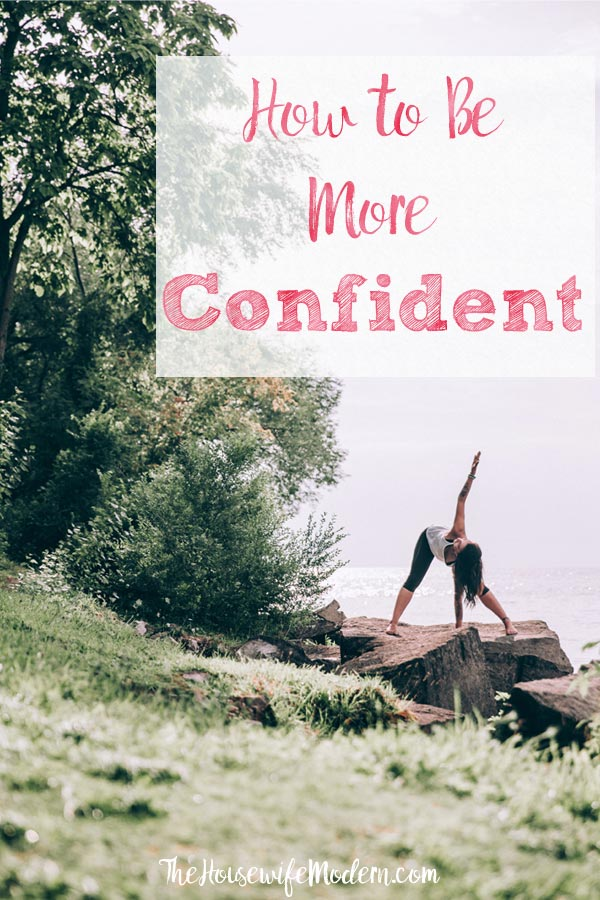 Pin image for article on how to build confidence. Woman in yoga pose with text overlay.