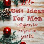 Pin image for 200+ gift ideas for men. Wood background, red ornaments, and evergreen with text overlay.