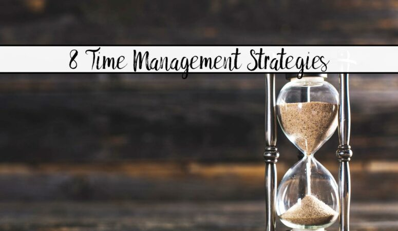 Featured image for 8 time management strategies. Hourglass with wood background and text overlay.