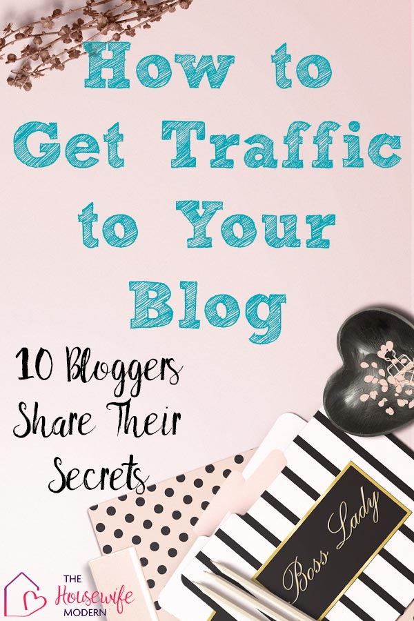 Pin image for how to get blog traffic. Pink desktop with text overlay.