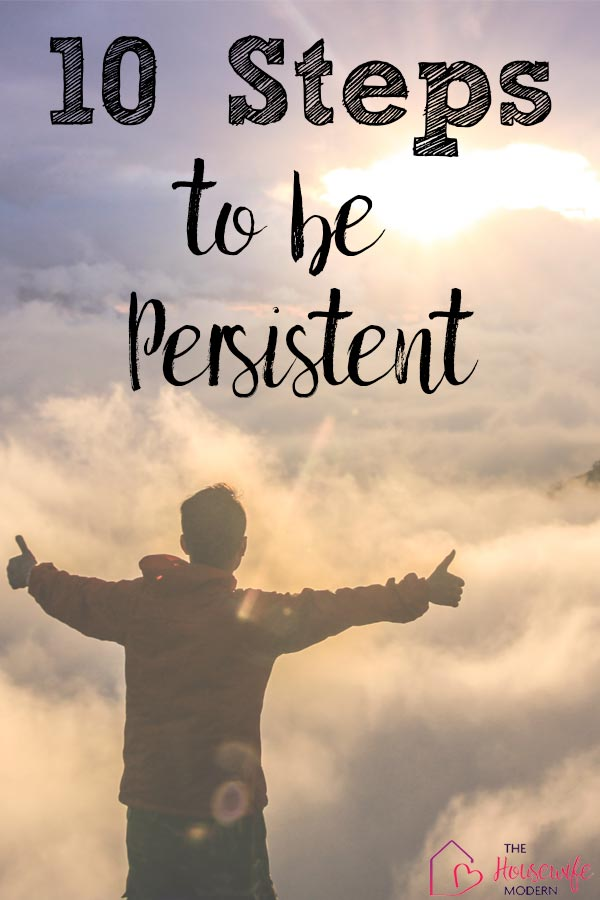Pin image for how to be persistent. Man on mountain, with clouds, thumbs up