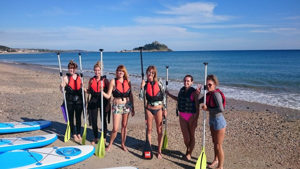 ladies stand up paddle boarding
