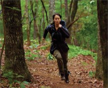 Movie Still: Katniss Running in The Arena