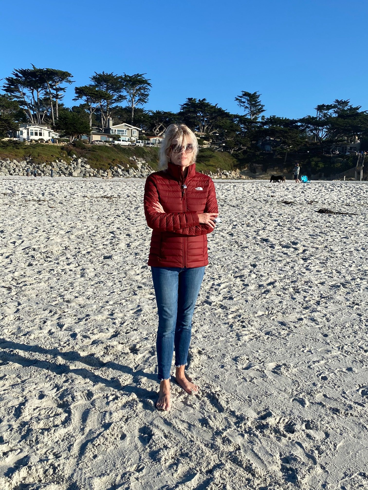 Woman standing on beach in Carmel