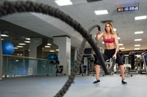 woman doing battle rope wave exercise