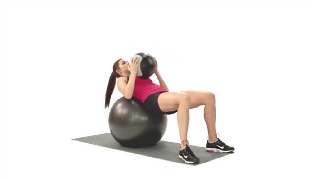 Women Doing Swiss Ball Crunch