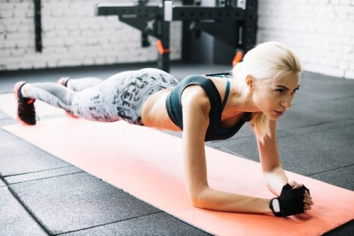 women standing in plank position