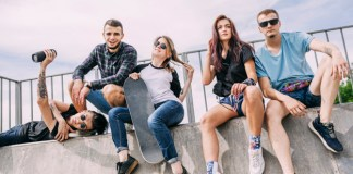 group of friends sitting and wearing trendy sneakers