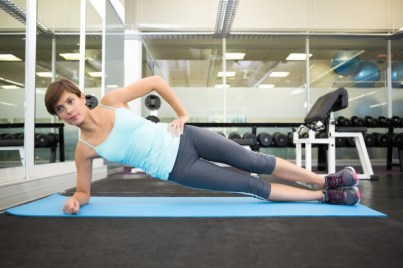 woman doing side plank exercise