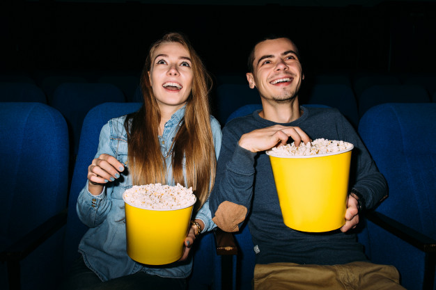 Couple watching a movie in cinema