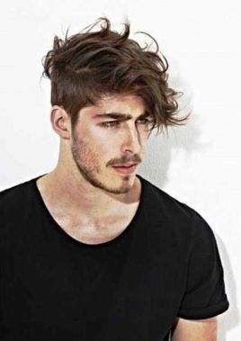 man with messy man bob hairstyle