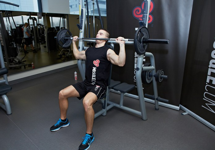 seated barbell shoulders press exercise