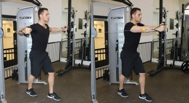 Man doing cable chest press exercise