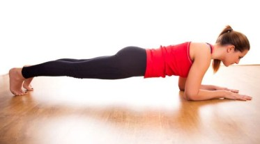 fit woman doing plank exercise