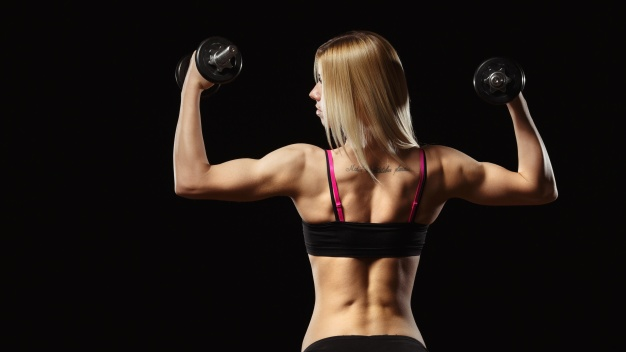 muscular-woman-his-back-lifting-weight