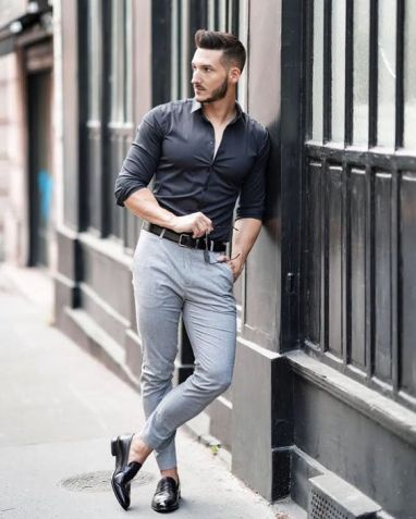 handsome man wearing black formals with chinos gray