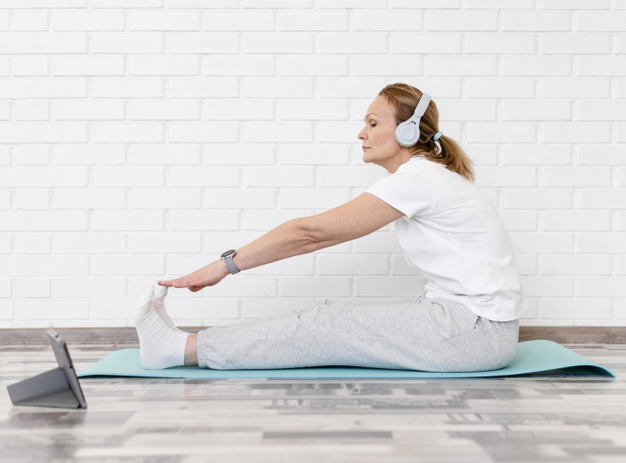 old healthy woman doing stretches exercise