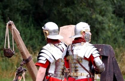Roman legionaries man the catapulta and the onager