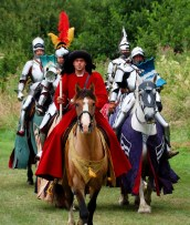 The marshal Sir Robert leads in the knights who will compete in the joust