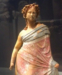 Tanagra-style figurine of a coquettish woman