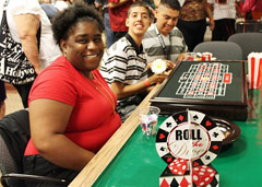 It's all smiles at the Roulette Table for Diedre Shields and Jose Cordera.