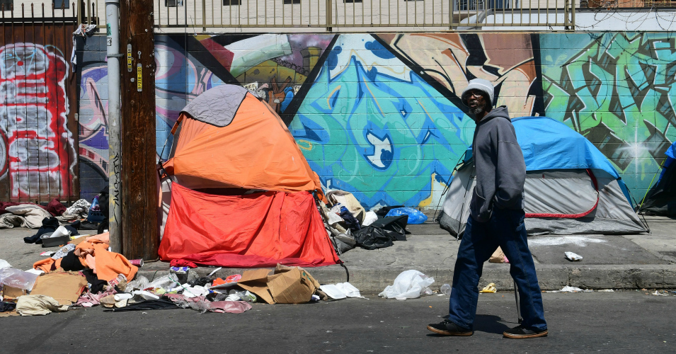 California homeless (source: wikicommons.org) Caption Rows of tents, cardboard shelters, battered RVs or makeshift plywood structures are visible in in communities across the state.