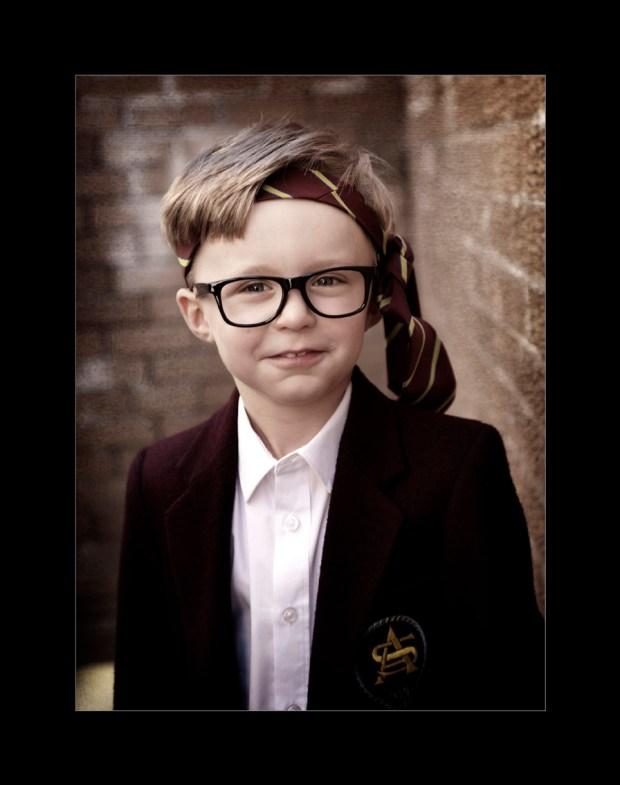 schoolboy with tie round his head