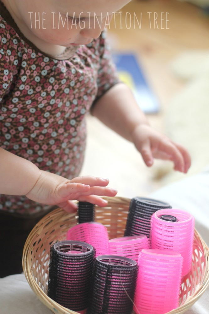 Baby-play-activity-with-hair-rollers