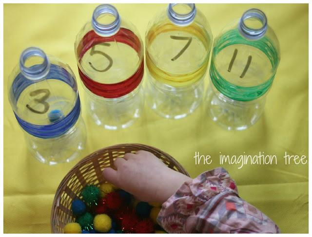 filling+bottles+with+pom+poms