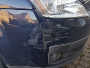 Scratched bumper school run car