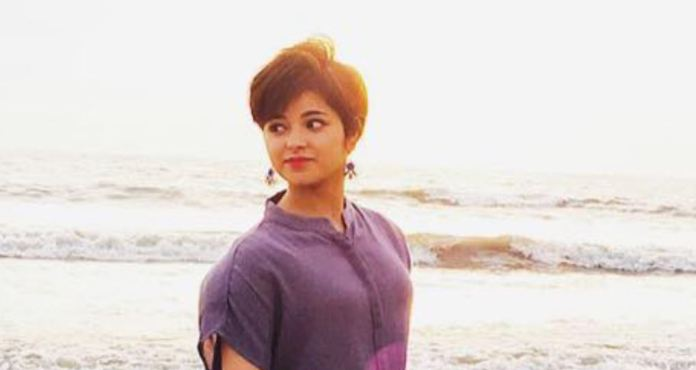 Zaira Wasim standing on the beach