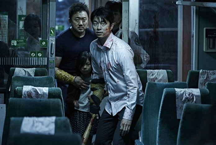 bloodied man standing in a train