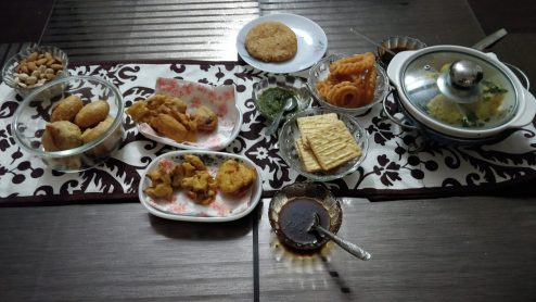 different types of indian snacks served with chutney on a table