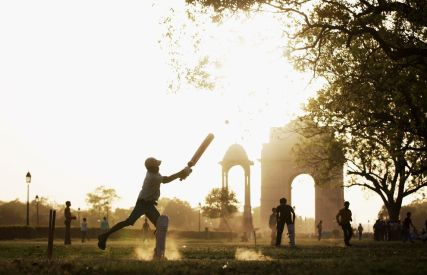 children playing cricket near India gate