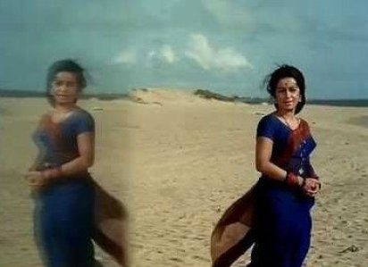 wind slowing and the actress is standing under the open sky, in a scene from ek pyaar ka nagma