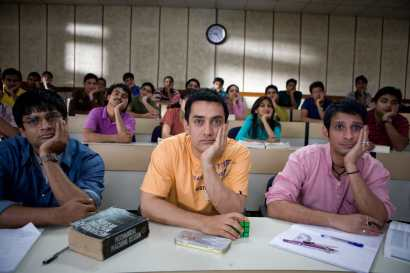 three studnets focused sitting in a class